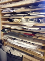 My studio has a wall with stacked wood shelf units that hold the papers I use for collage04